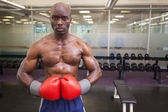 Muscular boxer in health club — Stock Photo