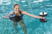 Blonde working out with foam dumbbells — Stock Photo