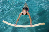 Blonde swimming with foam roller — Stockfoto