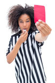 Pretty referee blowing her whistle and showing red card — Stock Photo