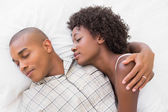 Happy couple sleeping in bed together — Stock Photo