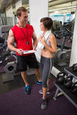 Handsome personal trainer speaking with his client — Stock Photo