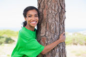 Pretty environmental activist hugging tree  — Stock Photo