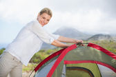 Blonde setting up her tent — Stock Photo