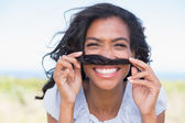 Funny woman making mustache with her hair — Stock Photo