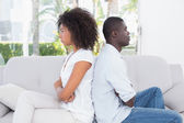 Attractive couple not talking on the couch — Stockfoto
