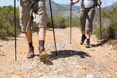 Hiking couple walking on mountain trail — Stock Photo