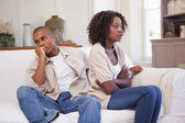 Unhappy couple arguing on the couch — Stock Photo
