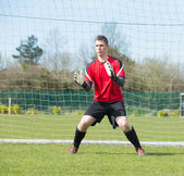 Goalkeeper in red ready to make a save — Foto de Stock