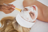 Beautiful blonde getting a facial treatment — Stock Photo