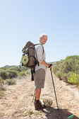 Handsome hiker smiling at camera in the countryside — Photo