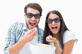Attractive young couple watching a 3d movie — Stock Photo