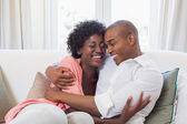 Happy couple relaxing on the couch — Stock Photo