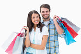 Attractive young couple with shopping bags — Foto Stock