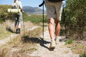 Hiking couple walking on country trail — Stock Photo