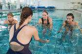 Fitness class doing aqua aerobic — Stock Photo