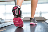 Womans feet running on the treadmill  — Stock Photo
