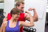 Fit attractive couple flexing their biceps — Stock Photo