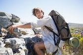 Hiker hiking through rough terrain — Stock Photo