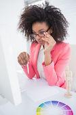 Casual graphic designer working at her desk   — Stock fotografie