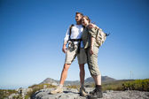 Hiking couple looking out over mountain terrain — Stock Photo