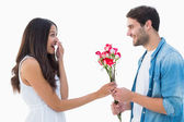 Happy hipster giving his girlfriend roses — Stock Photo