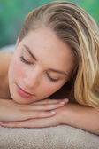 Peaceful blonde lying on towel  — Stock Photo