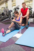 Personal trainer rubbing clients shoulders on mat — Stock Photo