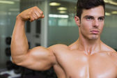 Close-up of muscular man flexing muscles — Stock Photo