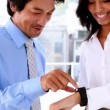 Businesswoman showing her smart watch to colleague — Stock Video #50442107