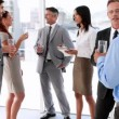Business people standing and talking — Stock Video #50442309