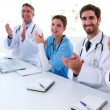 Medical team clapping during a meeting — Stock Video #50443963