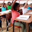 Pupils raising their hands during class — Stock Video #50447841