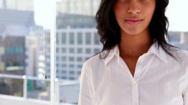 Pretty businesswoman smiling at camera — Stock Video