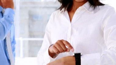 Businesswoman smiling and using a smart watch — Stock Video