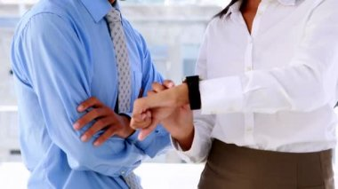 Businesswoman showing her smart watch to colleague — Stock Video