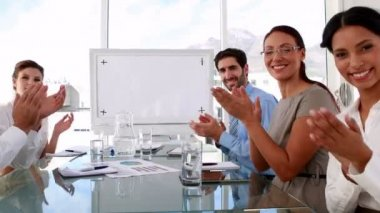 Business team applauding the camera at meeting — Vidéo