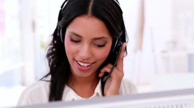 Call centre agent working and talking on headset — Stock Video