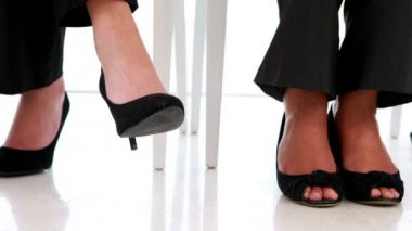 Businesswoman shaking her feet nervously — Wideo stockowe