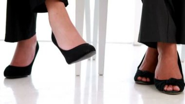 Businesswomen shaking their feet nervously — Video Stock