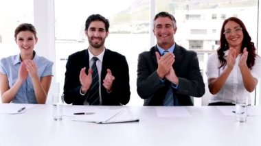 Interview panel applauding the camera — Vídeo Stock