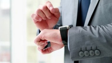 Businessman using his smart watch — 图库视频影像