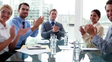 Business people clapping at camera in board room — Stock Video