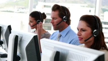 Happy call center employees at work — Stock Video