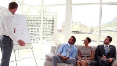 Business team listening to presentation — Stock Video