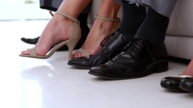 Business people shaking feet nervously waiting for interview — Vidéo