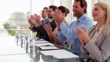 Interview panel applauding the applicant — Stockvideo