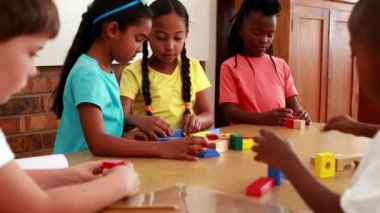 Pupils playing with building blocks — Video Stock