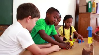 Pupils playing with building blocks — Stock Video