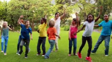 Teacher and pupils dancing together — Stock Video